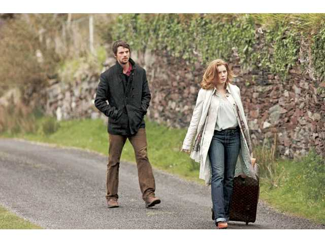 "Matthew Goode, left, and Amy Adams take a walk in ""Leap Year,"" which opens this week."