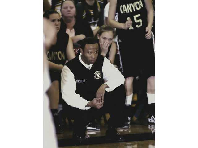 Canyon High School girls basketball coach, Stan Delus, observes his team during a game on Jan. 23, 2007.