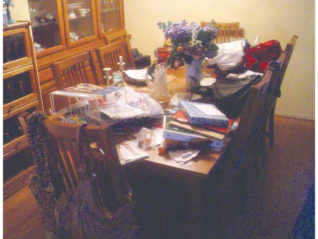 "Before photos of a cluttered dining room table. The New Year is the time to get organized, change your life and get rid of ""the clutters."""