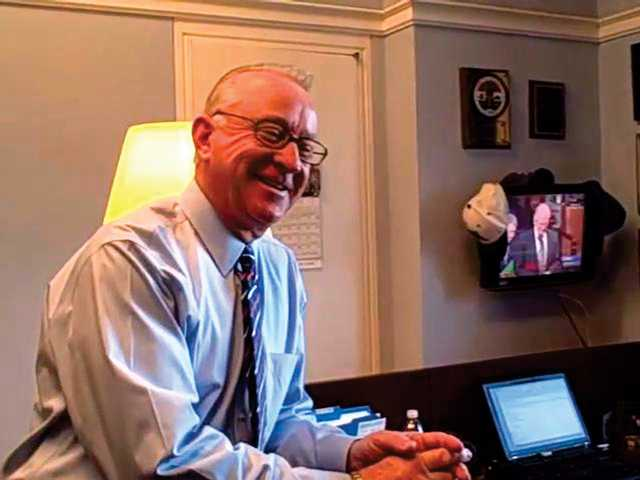 "Howard P. ""Buck"" McKeon (R) guides Web viewers through a tour of his Washington, D.C. office."