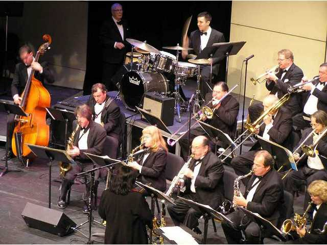 The COC Studio Jazz Ensemble swings at the Feb. 11, 2005 R.K. Downs Jazz Festival on the main stage at the Santa Clarita Performing Arts Center at COC. KC Manji conducts in the foreground; her predecessor Dirk Fischer, who had conducted almost 30 years and just retired, cheerleads the rhythm section in the background.