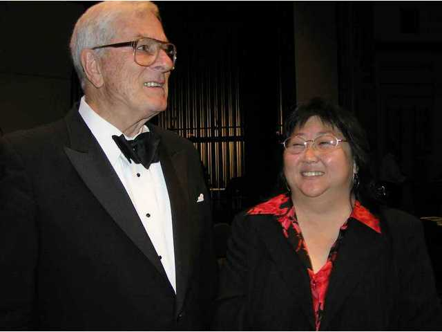 Dirk Fischer and KC Manji teamed to present the 2005 R.K. Downs Festival and conduct the keynote performance by the Studio Jazz Ensemble big band. Fischer had just turned over the baton to her, after 27 years as head of the COC music department and the band's conductor/arranger.