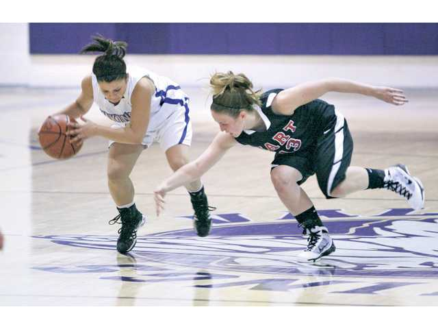 Valencia guard Madison Lanc, left, steals the ball from Hart guard Mariah Glasshoff Tuesday at Hart.