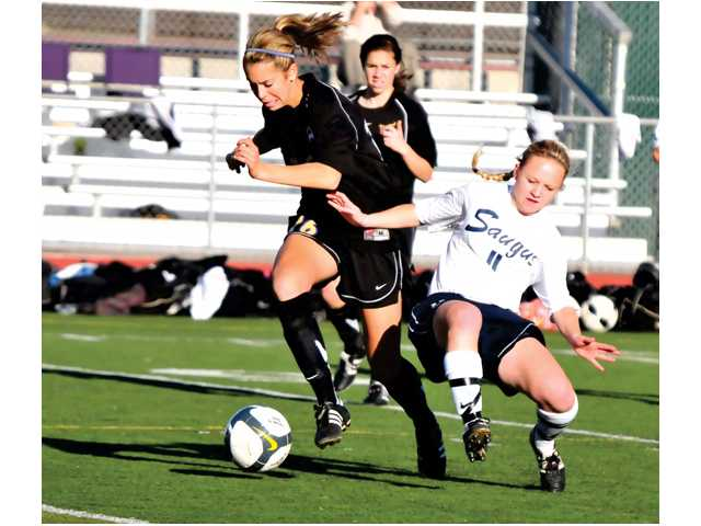 Valencia striker Kristen Bos breaks away from Centurion Jamie Molacek in first half action at Saugus High. Bos scored her 12th goal of the season to go along with two assists in the Vikings' win.