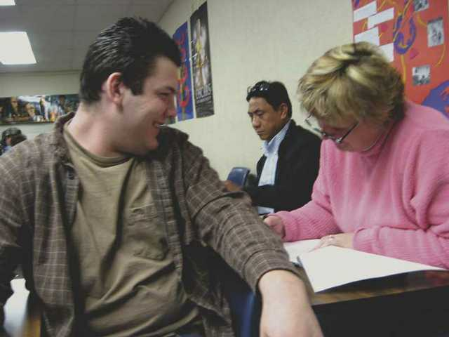 Cody and Jan Cooper fill out paperwork for Cody's trip to Washington, D.C., for the inauguration of President-elect Barack Obama. Jan Cooper said she is a bit envious of her son's chance to see the inauguration in person.