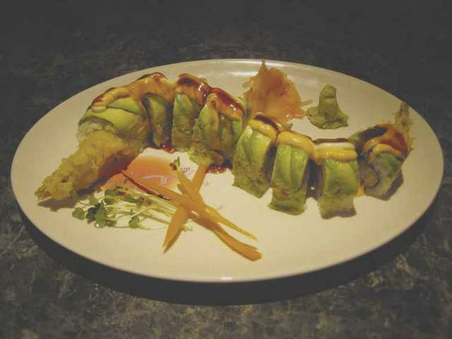 The Tempura Roll, $7.95, is one of the customer favorites at Kyoto Sushi - shrimp tempura topped with avocado, spicy mayo and eel sauce.