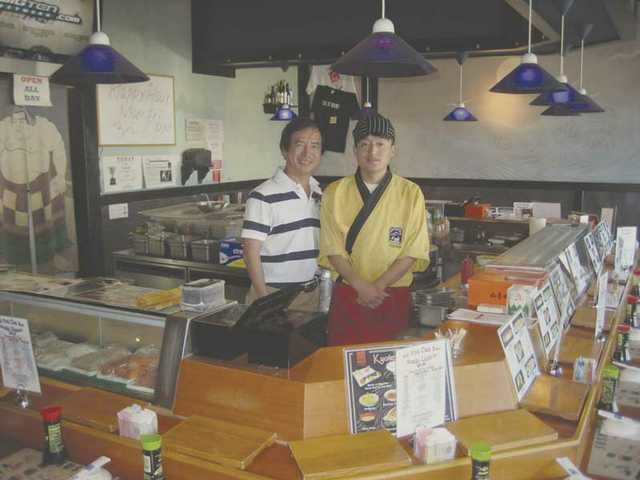Left to right: Chun Park, co-owner of Kyoto Sushi in Stevenson Ranch, stands with Jason Lee, sushi chef.