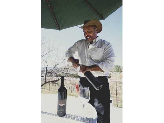 DiMaggio Washington opens a bottle of his 2005 Rancho Santiago Estates vintage estate syrah.