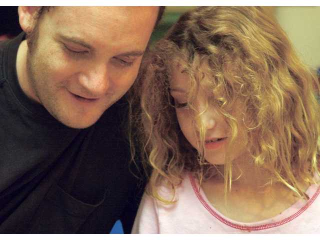 Jani's father Mike Schofield shares a moment with his daughter.