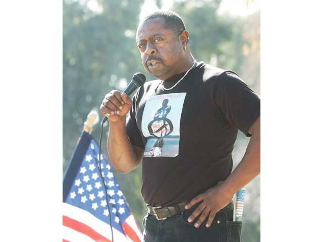 Jamiel Shaw gives an impassioned speech at an anti-illegal alien rally held at the corner of Valencia Boulevard and Magic Mountain Parkway on Saturday. Shaw's son, Jamiel Shaw II, 17, was shot to death in 2008 by an illegal alien who had an extensive police record and was released from custody the same day as the shooting.