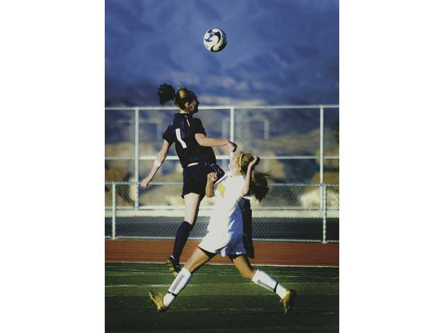 Saugus soccer player Shasta Fisher (1) goes up for a header next to West Ranch's Taylor Greasley Friday afternoon at West Ranch High. Saugus won the game 7-2.