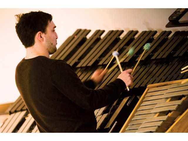 Master of Fine Arts music major, 23-year-old Matthew Cook practices his xylophone at the California Institute of the Arts, Friday afternoon.