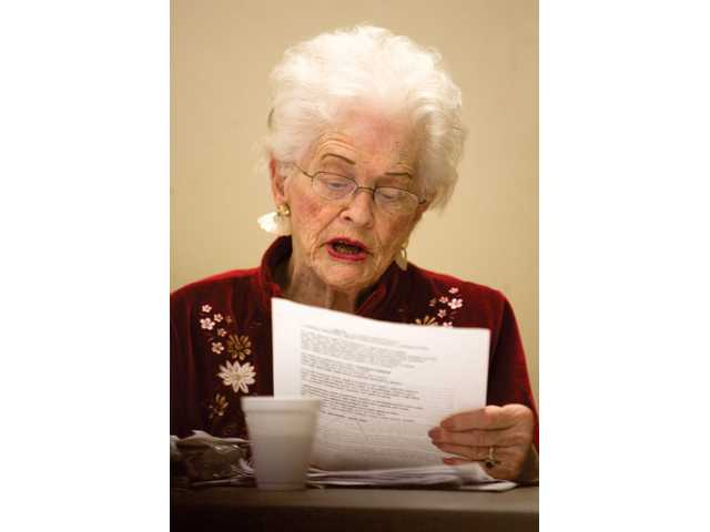Ruth May reads a short story during Tuesday's creative writing class at the Senior Center.