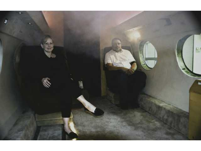 Carrie Curtis, left, of Santa Clarita, and Peter Rai, of Valencia, sit inside the fuselage of a G2 private jet trainer where HRD Aero Systems trains flight attendants and crew members for in-flight emergencies similar to the recent US Airways crash in the Hudson River. The simulator shakes, moves around, uses lights to recreate fire and incorporates smoke-filled cabins and a sound system.