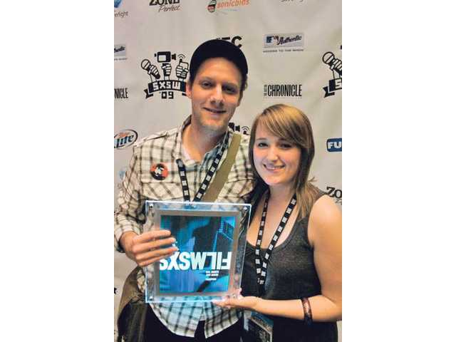 Jason Tippet and Elizabeth Mims hold the Jury Award for Short Film earned at the South by Southwest Film Festival in Austin, Texas, last March. Tippet and Mims - and their 10-minute film, 'Thompson' - will be at the Sundance Film Festival when it opens today in Park City, Utah.