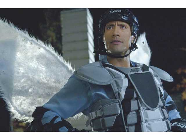 "Dwayne Johnson plays hockey player Derek Thompson, and a Tooth Fairy, in ""The Tooth Fairy."""