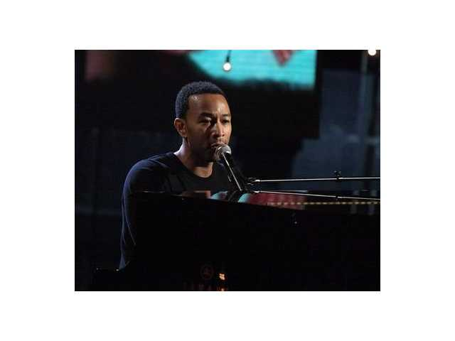 "In this image released by Hope for Haiti Now, John Legend performs at the ""Hope for Haiti Now: A Global Benefit for Earthquake Relief,"" on Friday, Jan. 22, 2010 in Los Angeles."