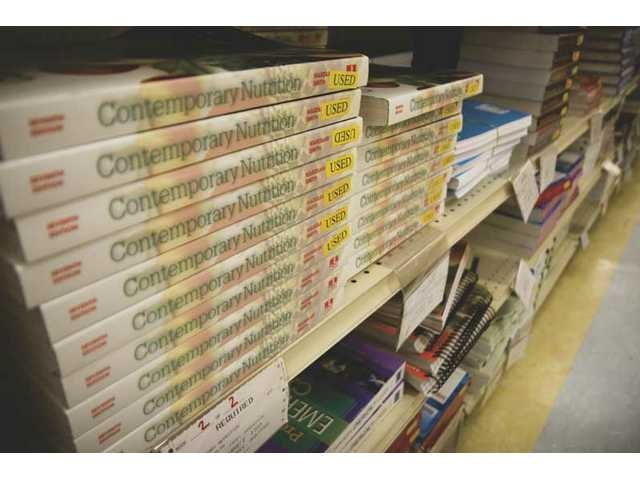 A stack of textbooks on display at COC campus bookstore.