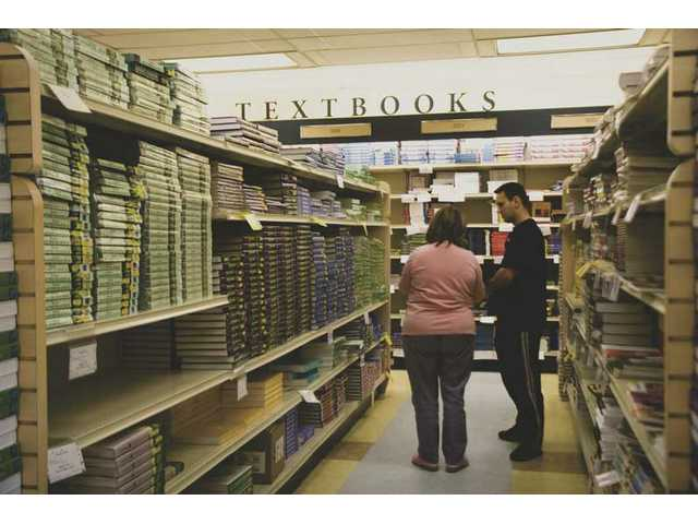 College of the Canyons students shop for textbooks at the campus bookstore, Tuesday afternoon.