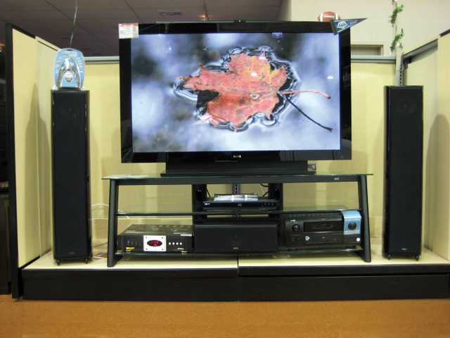 A Pioneer Elite 60-inch plasma television with floor-standing speaker package from Kef, Denon receiver powering the speakers, Sony Blu-Ray player, Monster power center and Bell'o stand. Combined, these components would normally sell for about $17,000, but are on sale, just in time for the Suberbowl, at about $15,000.