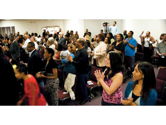 Church members from throughout Santa Clarita take part in the four-hour long prayer and singing service.