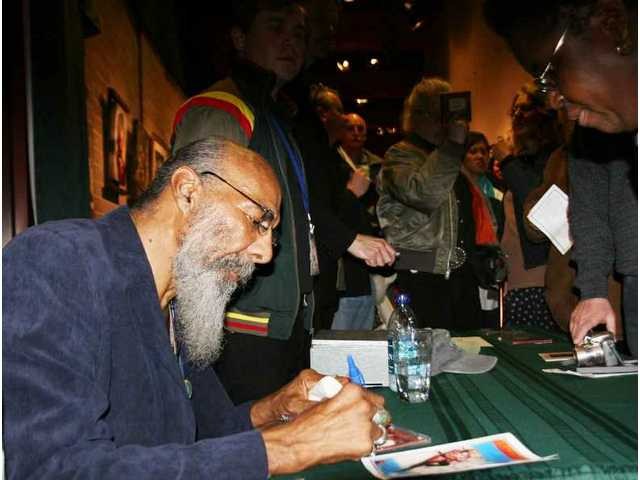 PHOTO UPDATE: Richie Havens signs copies of his CDs in the Palmdale Playhouse lobby for one of the many of the fans who stayed after the show to meet him. The concert Saturday night was nearly sold-out and well-received.