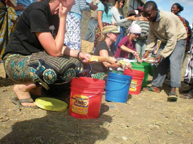 Dukov, sitting second from left, passed out beans and rice to the street kids of Mateves, Africa.