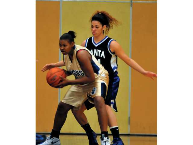 College of the Canyons' Joslynn Frazier, left, posts up Santa Monica City College's Jewll Morris Saturday.