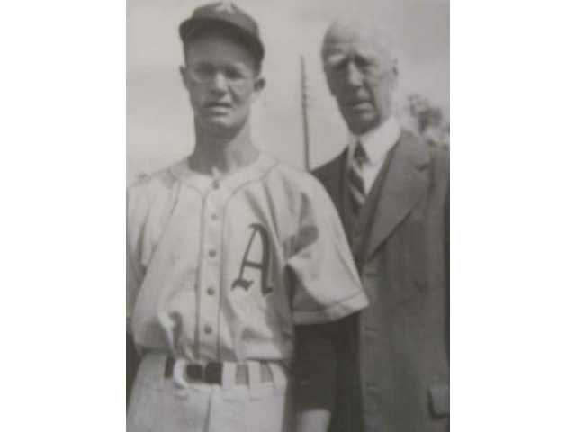Dillinger, then a member of the Philadelphia Athletics, poses with Connie Mack in 1949. Dillinger, 90, is one of the oldest living former Major Leaguers.