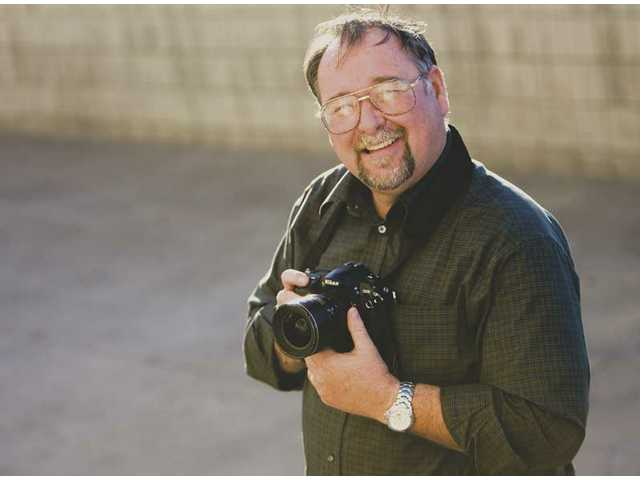 Dan Watson returns as photo editor