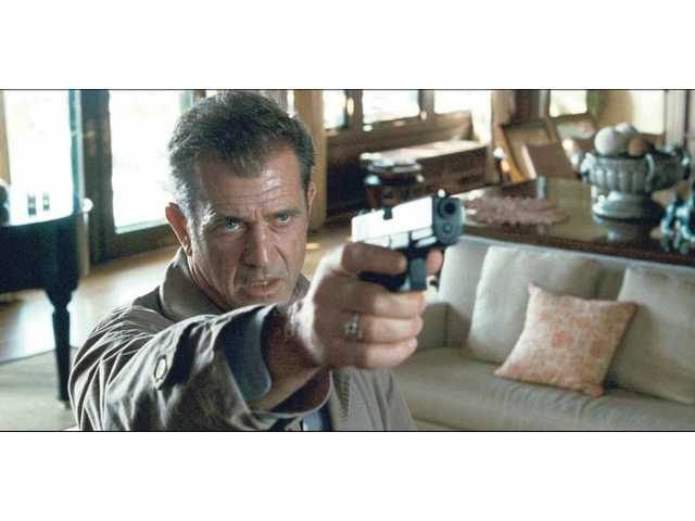 "Mel Gibson is shown in a scene from, ""Edge of Darkness."" Ebert feels Gibson's screen presence, combined with the interactions with Ray Winstone, give the movie much of its interest. Otherwise it is only a cranked-up thriller. ""Edge of Darkness"" opens at local theaters this week."