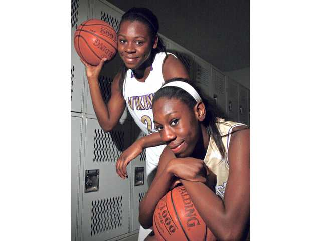 Valencia varsity basketball player Faith Anumba, left, and younger sister Jennifer, a junior varsity player, have helped keep the family's name alive at the high school.