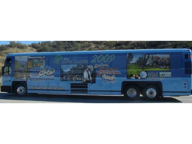 The City of Santa Clarita has taken the wraps off its new 45-foot commuter bus, wrapped to plug the city's big tourist-friendly events this spring.