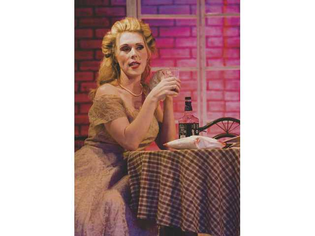 "Erin Michaels plays Blanche DuBois in ""A Streetcar Named Desire"" at the Repertory East Playhouse. Director Brad Sergi said he ""spiced up the sexuality and volume to bring it (the play) up to what we're used to."" Well-cast, the updated classic works well, taking you through a full range of emotions."