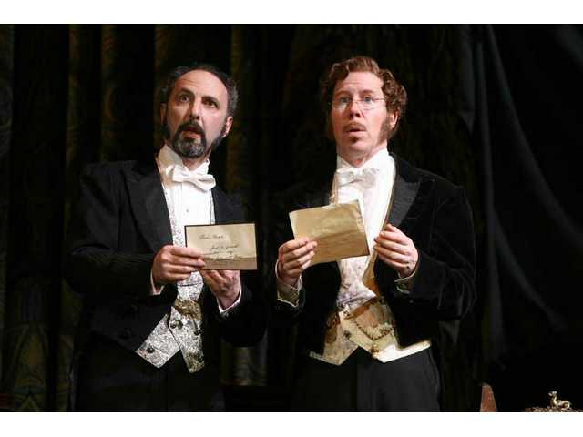 "Bruce Winant as Monsieur Firmin and D.C. Anderson as Monsieur Andre read notes from the ""Phantom."""