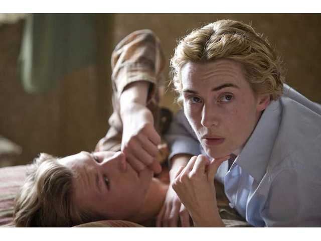 "Kate Winslet, right, has been nominated for a Best Actress Oscar for her role as a Nazi concentration camp guard in ""The Reader."" The film also stars David Kross as her teenage lover, Michael."