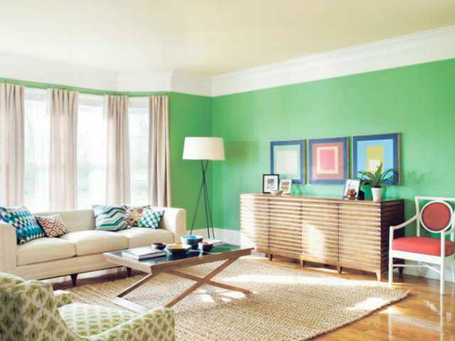 "A living room painted ""Cedar Green"" one of the 2010 featured colors by Benjamin Moore Paints."