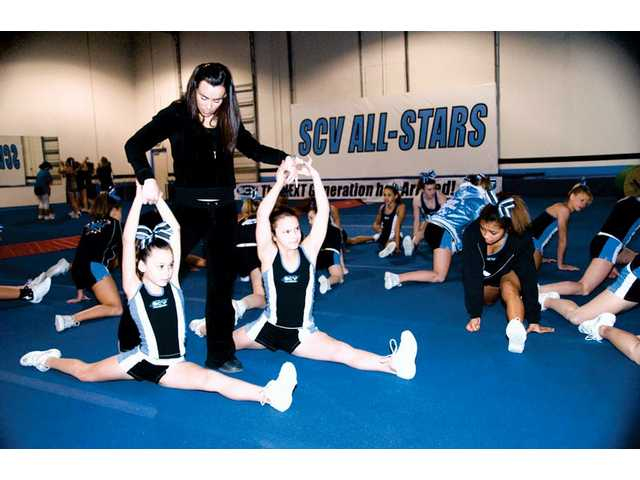 Danielle Wick works with cheerleading students in the SCV All-Stars program in the group's gym. The program is located on Constellation Road in Valencia. SCV All-Stars offers programs to children age 5-18.