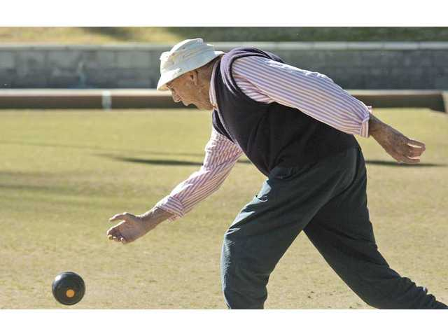 Friendly Valley resident Chuck Crawford, who has been bowling for six years, launches a shot as he competes with other members of the Friendly Valley Lawn Bowling Club on Thursday.