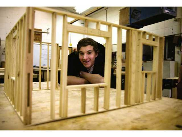 Brennon Viera, a Saugus High School junior, is working on a scale-model house in between projects in his woodshop class.