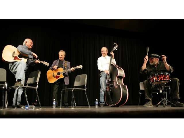 From left, Sonny Curtis, Bobby Vee, Joe B. Maudlin and Jerry J.I. Allison perform at the Stillman auditorium in Clear Lake, Iowa on Friday Jan. 30, 2009. The celebrations honor the 50-year anniversary of a crash that claimed the life of three rock 'n' roll legends, Buddy Holly, J.P. The Big Bopper Richardson and Ritchie Valens in February 1959. The trio performed in Clear Lake and then boarded a plane that soon crashed into a snowy Iowa corn field.