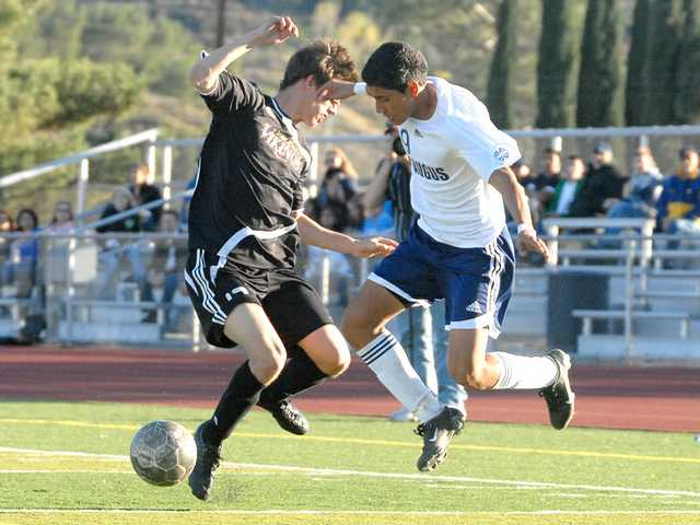 Centurion Erick Esquivel, right, tries to get past Viking Blake Sunderman Friday.