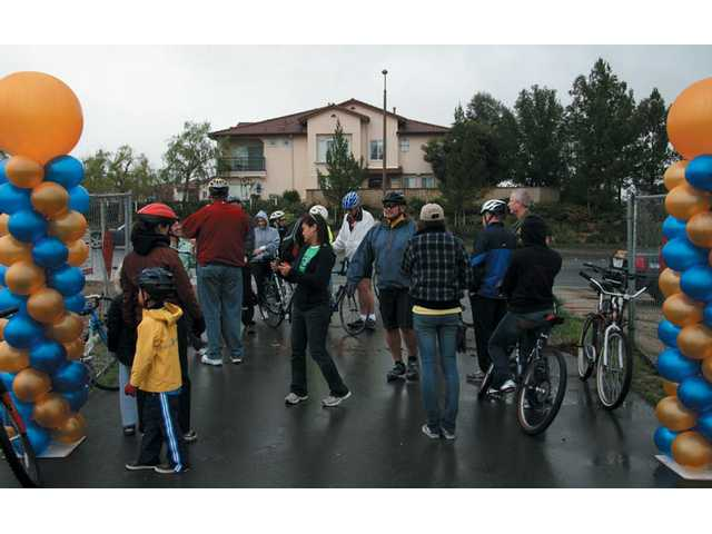 Participants gather in the rain near Valencia High School in preparation for the start of the event.