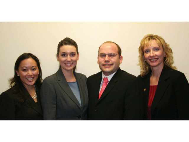 Representatives from Wells Fargo Community Banking, from left, Janice Dollar, Joni Lollio, Anthony Borradori and Marla Vasquez, after Lollio's promotion was announced.