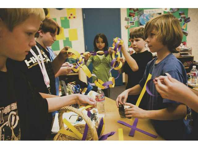 Rosedell Elementary School student leadership members work together to create a part of the Chain of Kindness. The three-week event concludes on Feb. 6 when the entire school will gather and link the paper chains together.