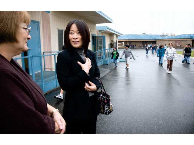 Sun Kim-Young, 'Principal for a Day' participant, right, talks with Live Oak Elementary School Principal Cynthia Seamands, left, Friday morning as they tour the campus. Future educators shadowed principals from more than 40 local schools to get a first-hand look at school life.