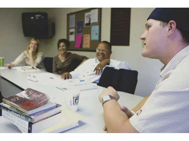 Student Elijah Wheeler, far right, looks on during a discussion in a night class for The Master's College's degree completion program. The Christian college saw a 20 percent spike in enrollment for the program in 2008.