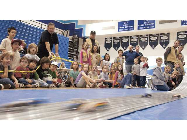 More than 150 participants, aged five to nine, took part in the Y-Guides Pinewood Derby race on Sunday at Saugus High School. The annual event is sponsored by the Santa Clarita Valley Family YMCA.