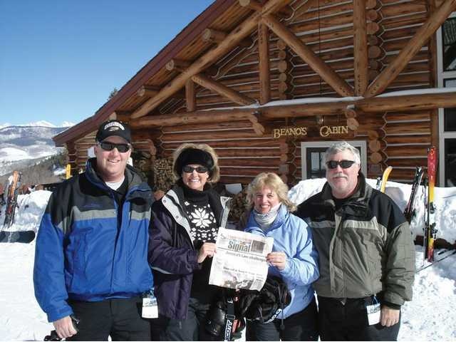 Jim and Jill Mellady and Mitzi and Randy Moberg, all from Santa Clarita, enjoy a short break from a perfect day of skiing in Beaver Creek, Colo., to have a nice hot drink at Beano's Cabin and read their copy of The Signal.