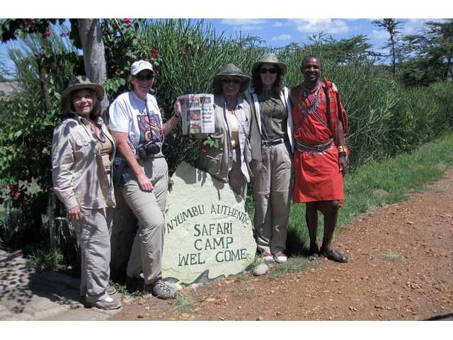 From left: Sylvia Altamirano of Valencia, Erin Fuller of Valencia, Dianne Erskine-Hellrigel of Newhall, Anjanette Butler of Santa Paula and Dominic, the Masai guide, take The Signal on tour in the Masai Mara in Kenya.